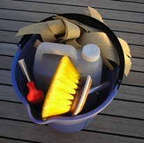 cleaning accessories in a bucket